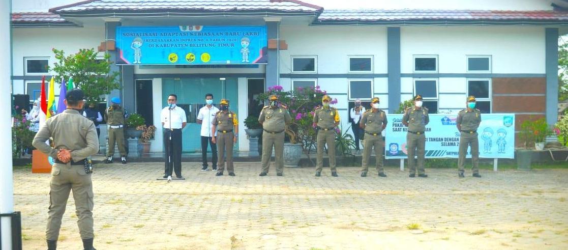 Bupati Beltim saat memimpin Apel HUT Sat Pol PP 2021, di Halaman Kantor Satpo PP Beltim, Kamis (3/3/2021).(foto: ist).